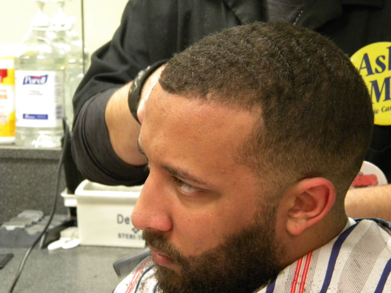 customer getting a fade haircut