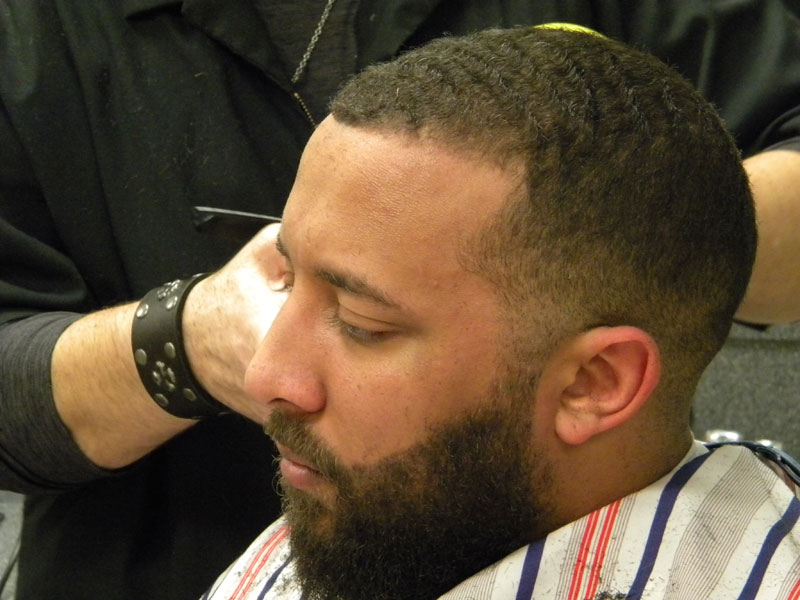 photo of barber doing a fade haircut